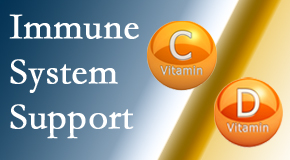 Spinal Care Clinic presents details about the benefits of vitamins C and D for the immune system to fight infection.
