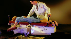 This is a picture of Cox Technic chiropratic spinal manipulation as performed at Spinal Care Clinic.