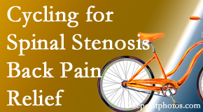 Spinal Care Clinic encourages exercise like cycling for back pain relief from lumbar spine stenosis.